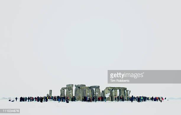 stonehenge in the snow during the winter solstice. - winter solstice stock photos and pictures