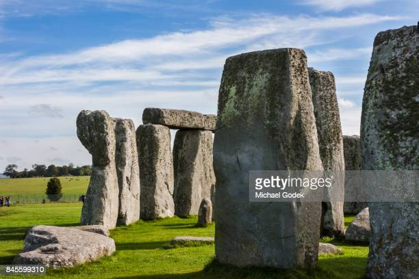 Stonehenge with bright blue sky and sweeping clouds