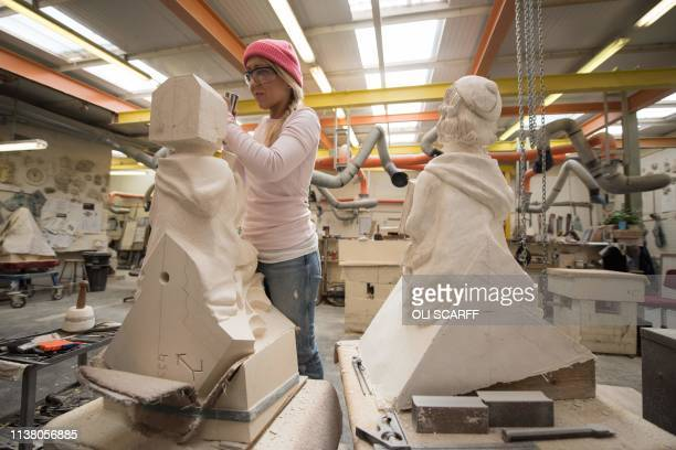 A stonemason carves new stonework in the Minster's Stoneyard in York northern England on April 18 2019 The stories of York Minster and NotreDame have...
