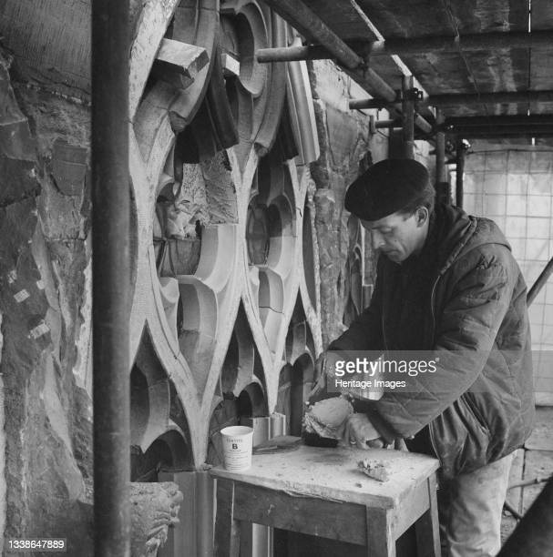 Stonemason working at Carlisle Cathedral applying SBD Certite during restoration on the tracery of a window. This photograph is part of a batch taken...