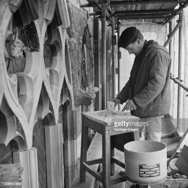 Stonemason working at Carlisle Cathedral preparing the tracery of a window for new stone to be held in by SBD Certite. This photograph is part of a...