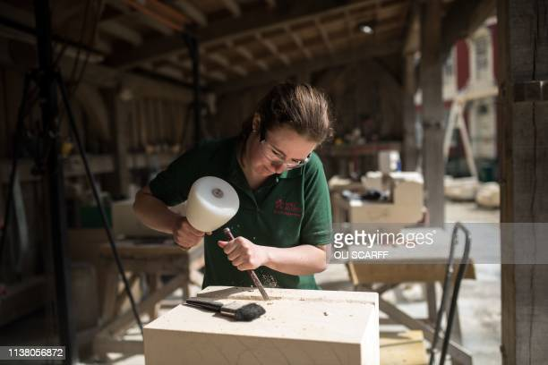 Stonemasons carve new stonework in the Minster's Stoneyard in York, northern England on April 18, 2019. - The stories of York Minster and Notre-Dame...