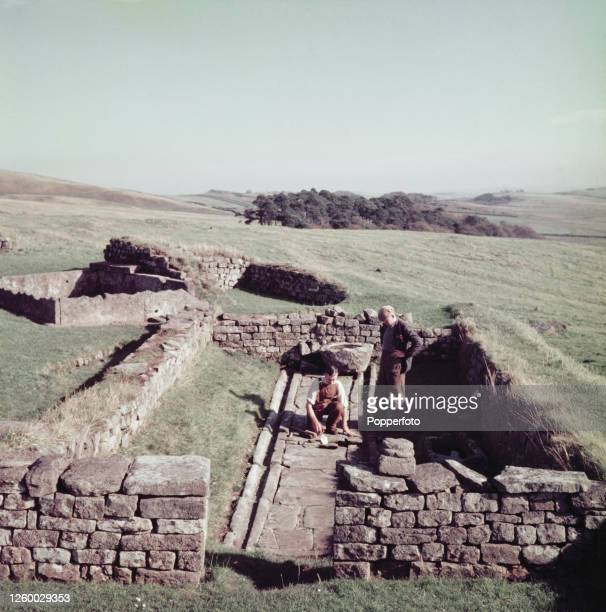 Stonemasons make repairs to the paving at Coria Roman fort and town located near Hadrian's Wall on the edge of the village of Corbridge in...