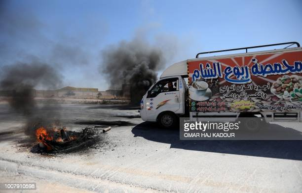 Stonemasons protest near the key junction of Morek in the Syrian Idlib province on July 8 2018 after duties per truckload of transported merchandise...