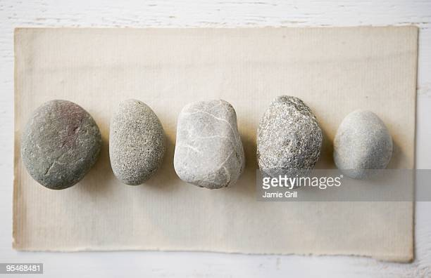 stones in a row - pebble stock pictures, royalty-free photos & images