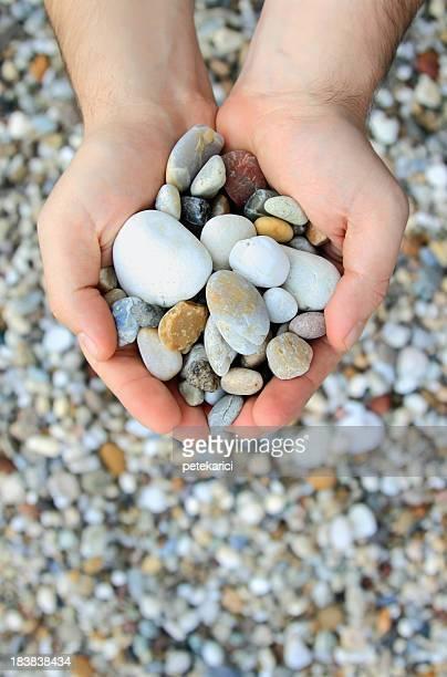 Steine in den Händen