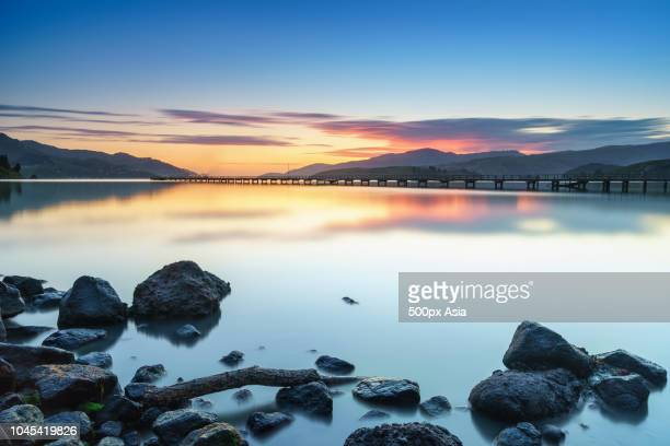 stones in lake at sunset, new zealand - image stock pictures, royalty-free photos & images