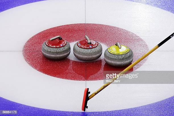 Stones lie in the house during a match between Great Britain and the United States during a preliminary round of men's curling on Day 9 of the Turin...