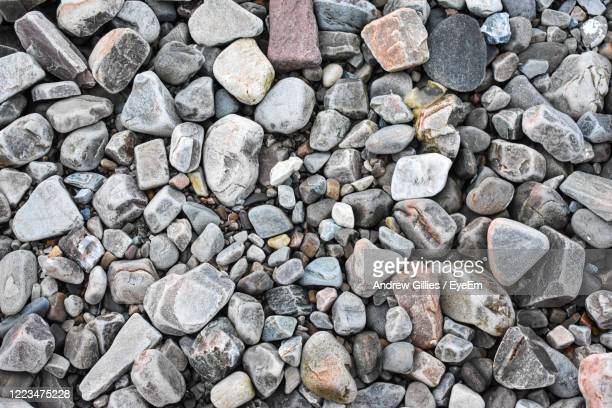 stones on beach - pebble stock pictures, royalty-free photos & images