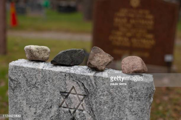 stones on jewish grave - judaism stock pictures, royalty-free photos & images