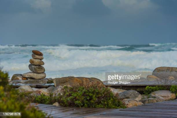 stones piled in spiritual stack - pebble stock pictures, royalty-free photos & images