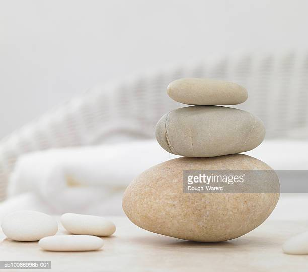 Stones piled up on one another with towels in background