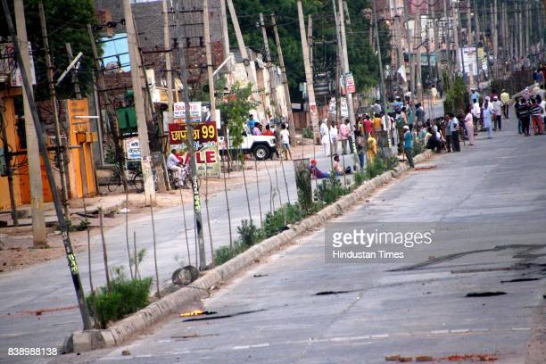 Stones scattered on road pelting by dera followers on Begu road in Sirsa on Fridayon August 25 2017 in Sisra India Gurmeet Ram Rahim the selfstyled...