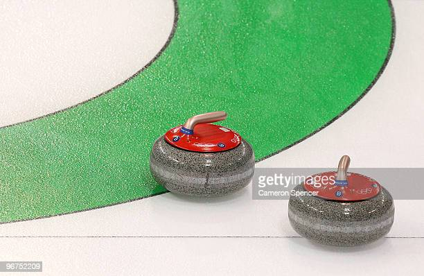 Stones settle on the house during the men's curling round robin game between the United States and Germany on day 5 of the Vancouver 2010 Winter...