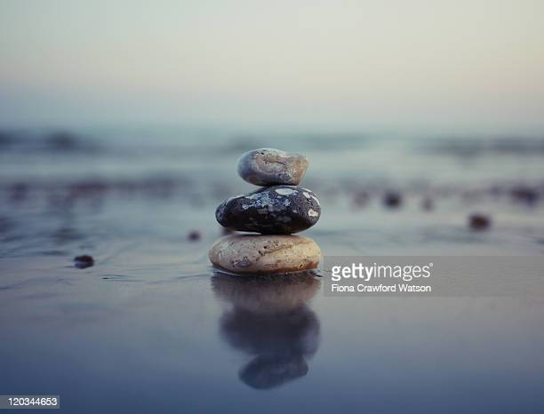 Stones stacked reflection on beach