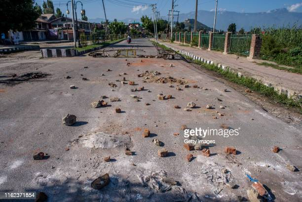 Stones thrown by Kashmiri protesters at Indian forces lie in the road in the Habba Kadal after a protest against revocation of Article 370 and...