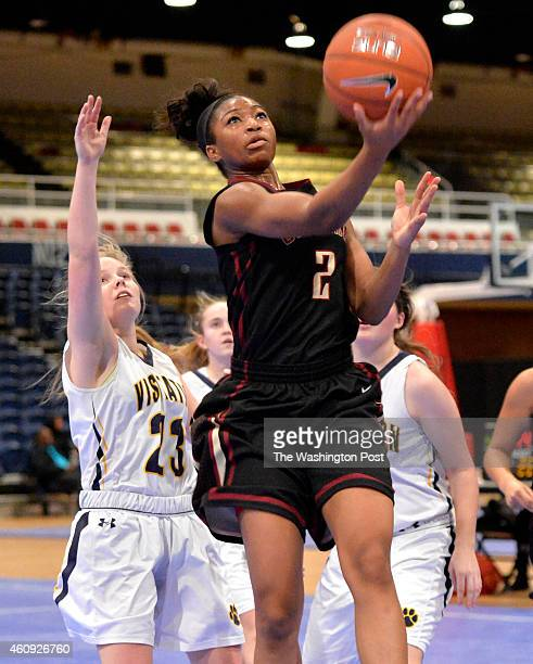 Stonewall Jackson's Genesis Parker sails to the basket pass Georgetown Visitation's Keelyn Leonard in the Title IX Holiday Invitational Classic at...