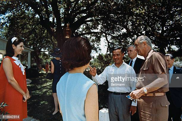 President Lyndon B Johnson greets Rene Barrientos Ortuno President of Bolivia at the LBJ ranch At the left is Mrs Lynda Bird Robb daughter of...