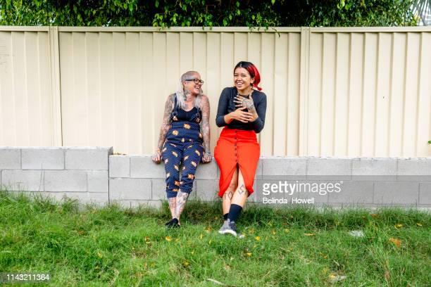 stong, independent, artistic, business women who design and create tattoos from their bright and unique shop - cultura australiana - fotografias e filmes do acervo