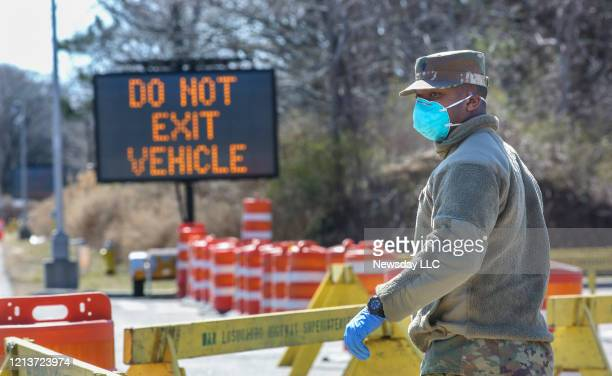 A member of the National Guard is in position to direct traffic as drive through coronavirus testing was set to began shortly after noon on March 18...