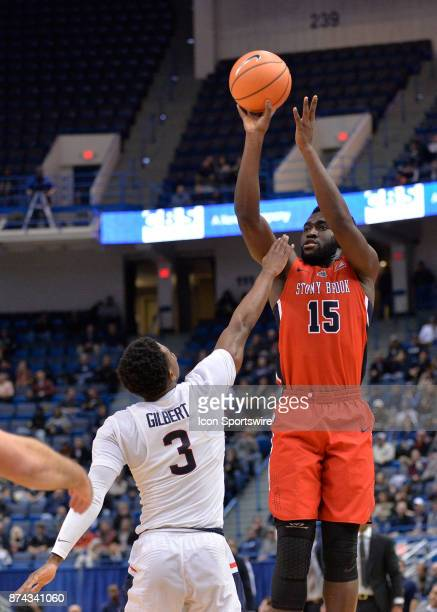 Stony Brook Seawolves Guard / Forward Akwasi Yeboah shoots over UConn Huskies Guard Alterique Gilbert during the game as the UConn Huskies host the...