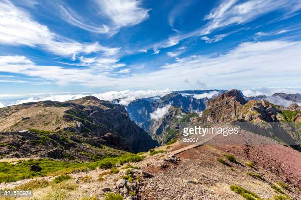 stony hiking path above the clouds - madeira island stock photos and pictures