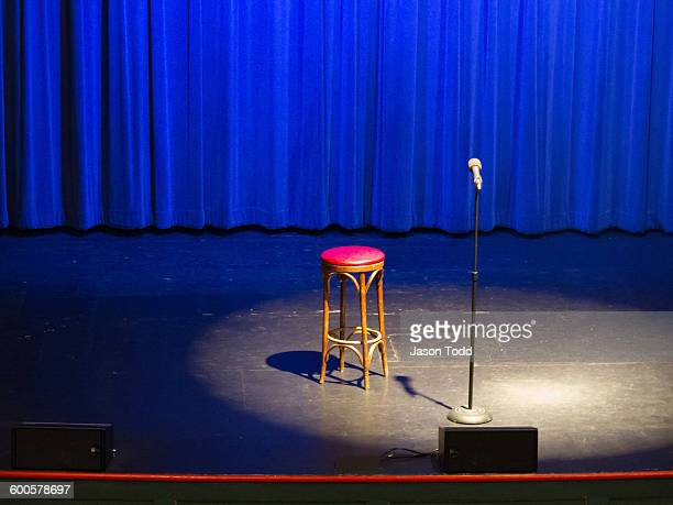 Stool on stage under spotlight at comedy show
