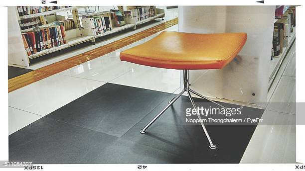 Stool with shelves of books