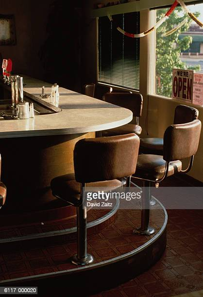 stools along bar of diner - diner stock pictures, royalty-free photos & images