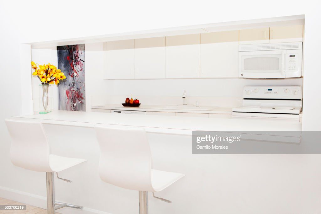 Stools and breakfast bar in modern kitchen : Foto stock