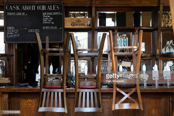 Stools are placed on a bar in a closed pub in Clapham Junction on May 18, 2020 in London, England. The British government has started easing the...