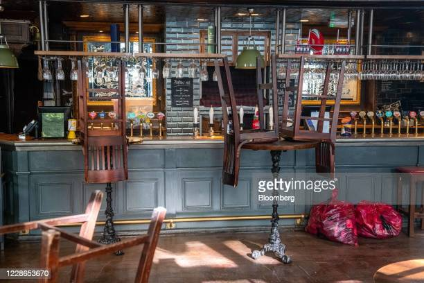Stools sit on top of tables at the currently closed The Marquis of Granby pub in London, U.K., on Tuesday, Sept. 22, 2020. From Thursday, hospitality...