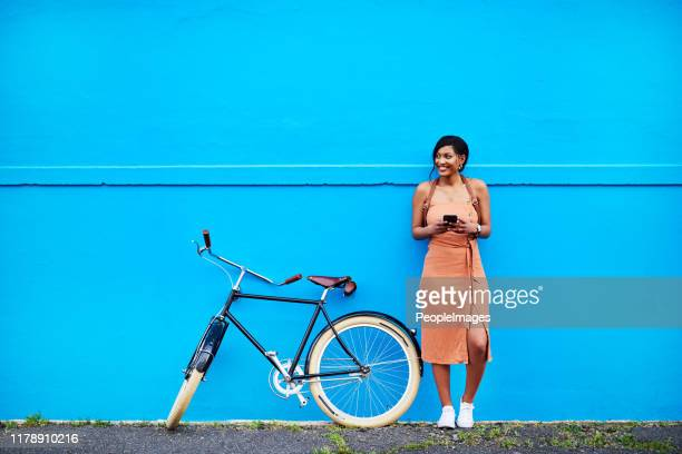 stop and connect with your surroundings - woman blue background stock pictures, royalty-free photos & images