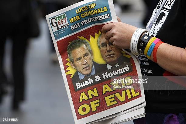 Stop Bush Campaign protester holds leaflets outside Sydney Town Hall on September 6 2007 in Sydney Australia US President George W Bush is attending...