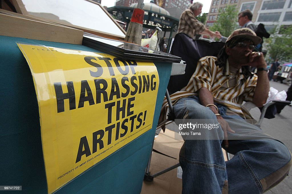 A 'Stop Harassing the Artists' sign is displayed in Union Square May 17, 2010 in New York City. Mayor Michael Bloomberg's administration wants to cut the number of art vendors in Union Square Park, Battery Park, High Line Park and certain areas of Central Park by 75 percent. Vendors currently are not required to have permits to sell 'expressive art' and fear they will lose the opportunity to sell their work in the popular outdoor galleries.