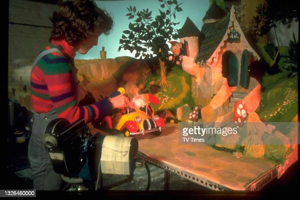 Stop motion animator Marj Graham photographed working on a sequence in the children's show Noddy, circa 1975.