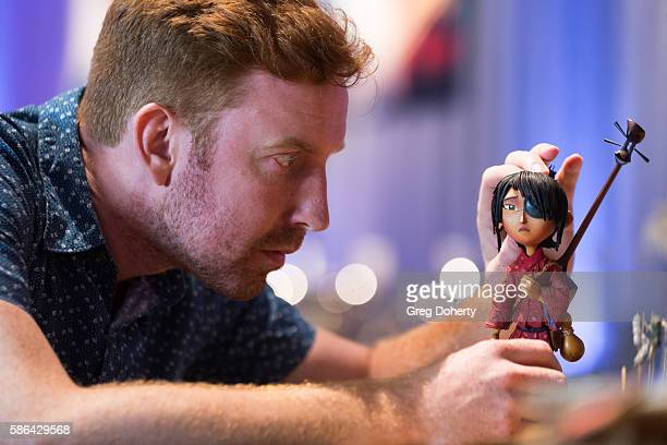 Stop Motion Animator Mike Hollenbeck positions a character while demonstrating the stop motion technique at the From Coraline To Kubo A Magical Laika...