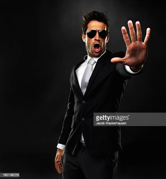 stop! - bodyguard stock pictures, royalty-free photos & images