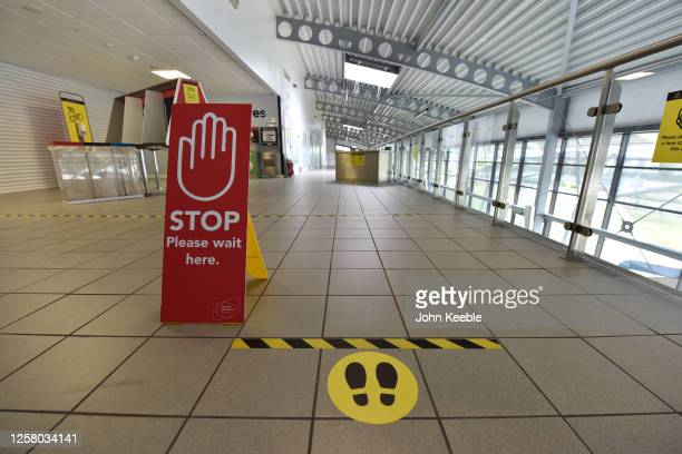"""Stop, please wait here"""" sign by the entrance of the departure gate as London Southend airport prepares for the reintroduction of passenger flights on..."""