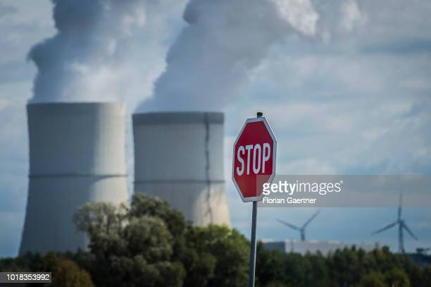 A stop road sign is pictured between wind turbines and the lignitefired power station of Schwarze Pumpe on August 15 2018 in Terpe Germany