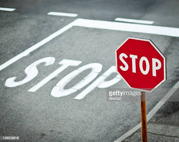Stop Road Signal With White Sign Painted On Asphalt