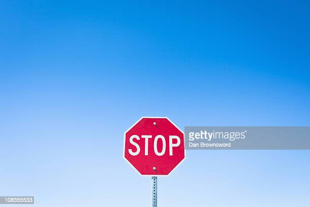 stop sign against blue sky - forbidden stock pictures, royalty-free photos & images