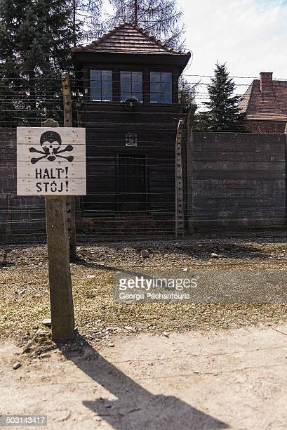 CONTENT] Stop sign and watch tower in AuschwitzBirkenau concentration camp