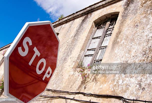 stop sign in front of old ruins, andalucia, spain, europe - captions stock photos and pictures