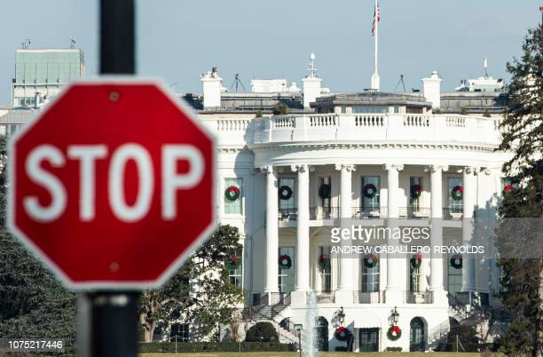 TOPSHOT A stop sign is seen near the White House during a government shutdown in Washington DC December 27 2018 Congress members trickled back into...