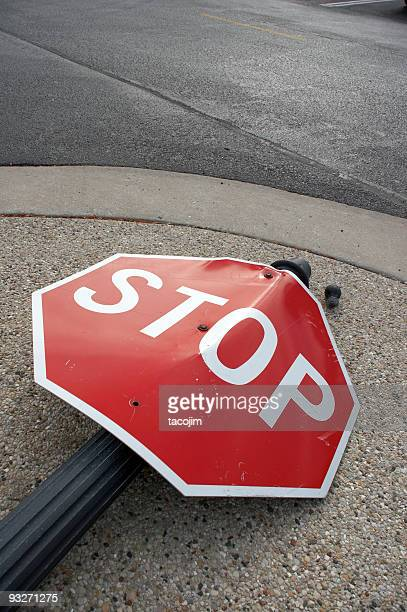 Stop sign lying in the street as the result of an accident