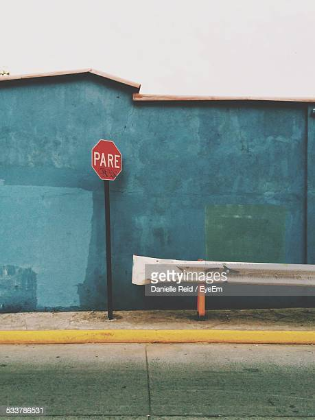 stop sign near crash barrier - danielle reid stock pictures, royalty-free photos & images