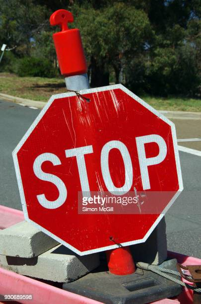Stop sign on a plastic road block barrier