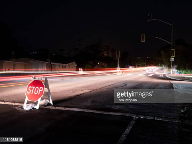 stop sign on the road where the traffic lights are out at crestmoor drive and san bruno avenue. pg&e power shutoff in san bruno, san mateo county, san francisco and bay area - san stock pictures, royalty-free photos & images