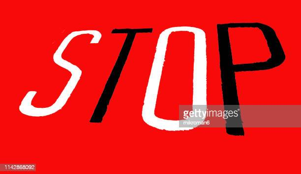 stop sign painted on street - road sign stock pictures, royalty-free photos & images